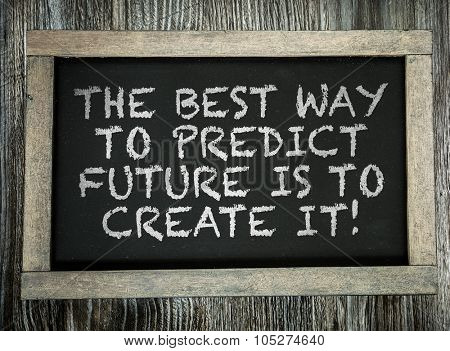 The Best Way to Predict Future is to Create it! written on chalkboard poster