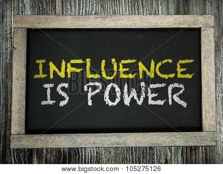 Influence is Power written on chalkboard