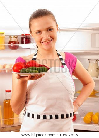 Young Cook Smiling With Frash Vegetables