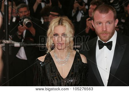 CANNES, FRANCE - MAY 21: Madonna (L) and Guy Ritchie attend the 'Che' premiere at the Palais des Festivals during the 61st International Cannes Film Festival on May 21, 2008 in Cannes, France.