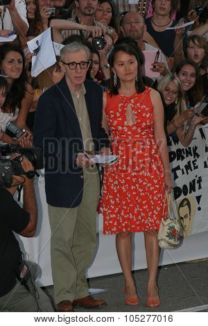 VENICE - SEPT 2:Woody Allen and Sonn Yi attend the Cassandra's Dream premiere on the Day 5 of the 64th Annual Venice Film Festival on September 2, 2007 in Venice, Italy.