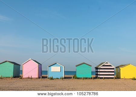 Row of coloured beach huts at the seaside