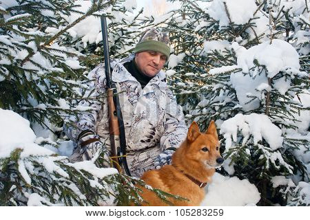 Hunter With Dog In Winter Forest
