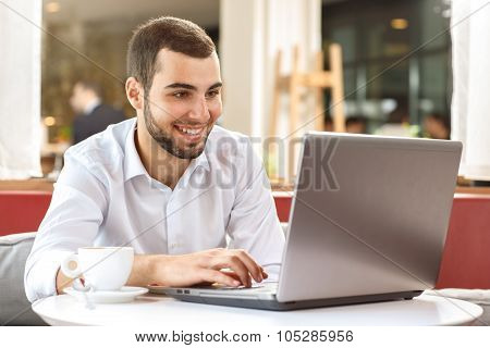 Handsome businessman on coffee break
