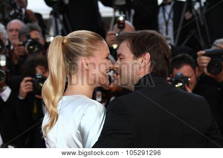 CANNES, FRANCE - MAY 15: Clovis Cornillac and Lilou Fogli attends the 'The Artist' Premiere during the 64th Cannes Film Festival at Palais des Festivals on May 15, 2011 in Cannes, France