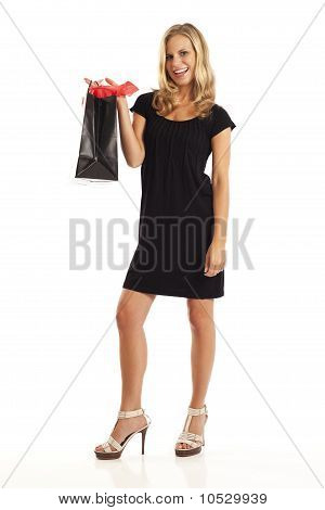 Young woman in black with red and black shopping bag