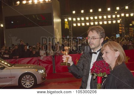 BERLIN, GERMANY - FEBRUARY 16: Calin Peter Netzer (winner of Golden Bear) and Ada Solomon attend the Closing Ceremony At The 63rd Berlinale Festival at Palast on February 16, 2013 in Berlin, Germany.
