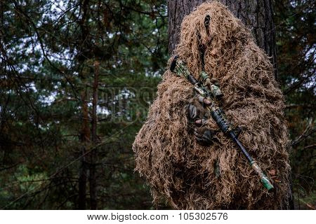 Camouflaged Sniper Holding Rifle