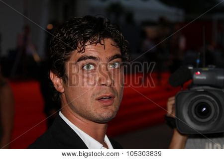 VENICE, ITALY - AUGUST 29:  Riccardo Scamarcio a guest of Jaeger-LeCoultre appearst for the 'Emergency' during the 70th Venice Film Festival at the Palazzo  on August 29, 2013 in Venice, Italy.