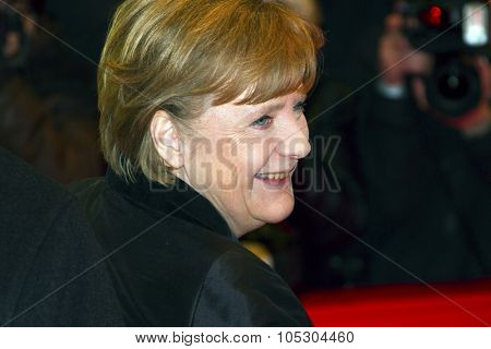 BERLIN, GERMANY - FEBRUARY 13: German Chancellor Angela Merkel  and Bernd Neumann attend the 'Pina' Premiere during of the 61st Berlin Film Festival at Palace on February 13, 2011 in Berlin, Germany