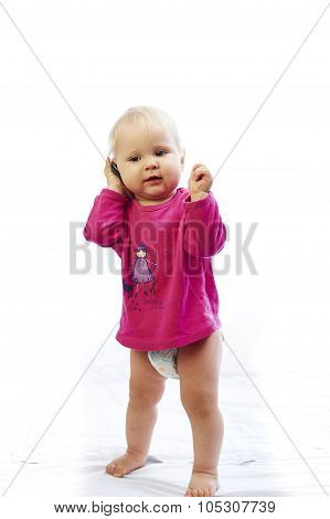 baby is playing with phone over white background
