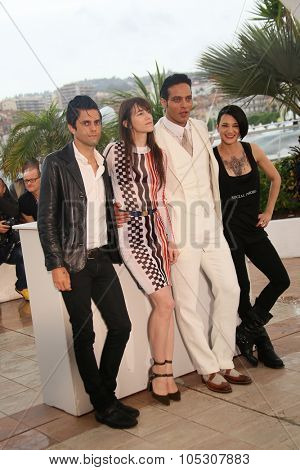 CANNES, FRANCE - MAY 22: Actors Charlotte Gainsbourg, Gabriel Garko and  Asia Argento attend the 'Misunderstood' photocall at the 67th Annual Cannes Film Festival on May 22, 2014 in Cannes, France.