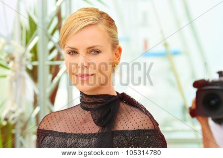 Charlize Theron attends the 'Mad Max : Fury Road' Photocall during the 68th annual Cannes Film Festival on May 14, 2015 in Cannes, France.