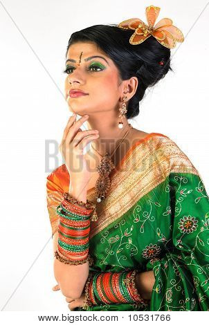 Woman in rich sari and accessories