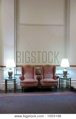 Two Easy Chairs In Lobby With High Ceiling