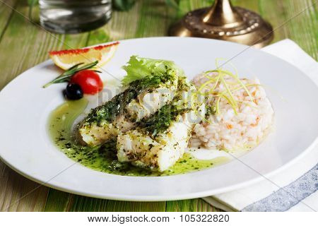 white fish with pesto sauce and meat plate in a still life gourmet restaurant