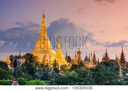 Yangon, Myanmar view of Shwedagon Pagoda at dusk.