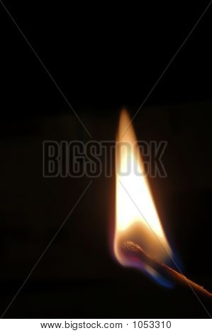 Isolated Picture Of A Lighted Match On Dark Background