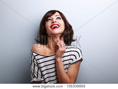 Happy Natural Toothy Laughing Young Woman Looking Up