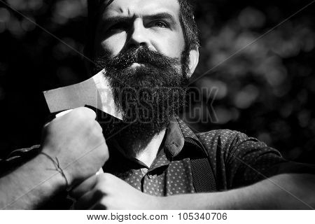 Man Holding One Axe