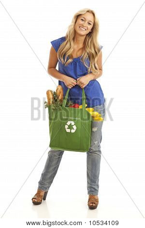 Young woman with healthy food and vegetables