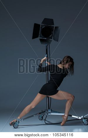 The Beautiful Ballerina Posing On Dack Blue Background