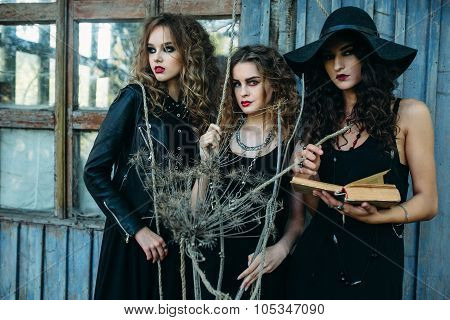 three vintage women as witches