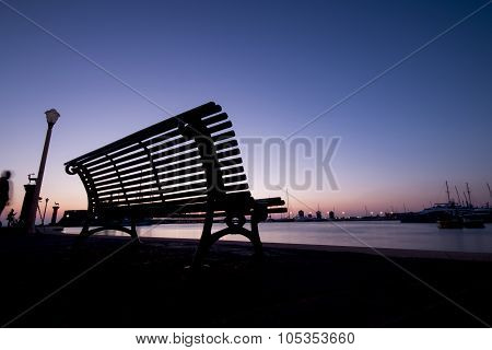 Wonderful Sunrise And Silhouette On A Bench