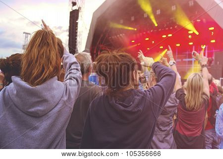 Crowd With Arms In Air At An Outdoor Music Festival