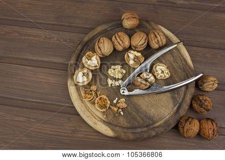 Peeling fresh walnuts, walnut dessert preparation. Walnuts on the kitchen table.