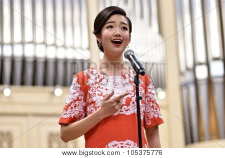 ST. PETERSBURG, RUSSIA - OCTOBER 6, 2015: Soprano Yui Don Ni from Star Sopranos of China on the rehearsal with the Andreyev State Russian Orchestra in the Philharmonic Hall