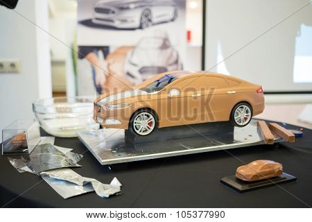 RUSSIA, MOSCOW -?? 4 DEC, 2014: A clay model of the car on the table at the press event for Ford in SREDA loft.