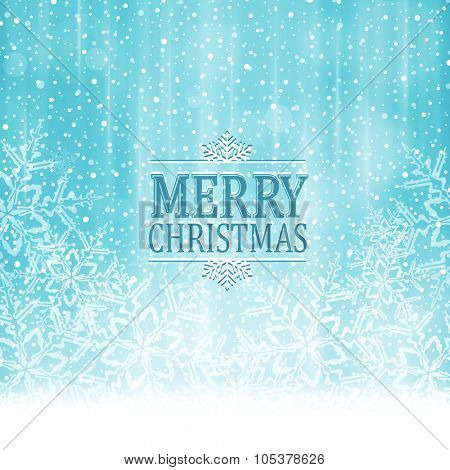Abstract soft blue white winter, Christmas card with snowflakes, snowfall, out of of focus light dots and light effects and the wording Merry Christmas.