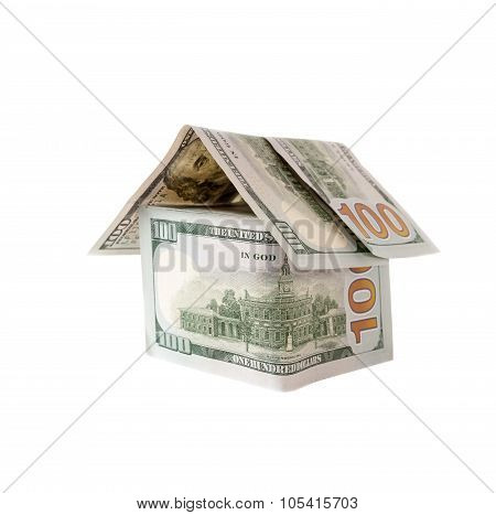 House made of hundred dollar bills isolated on white.