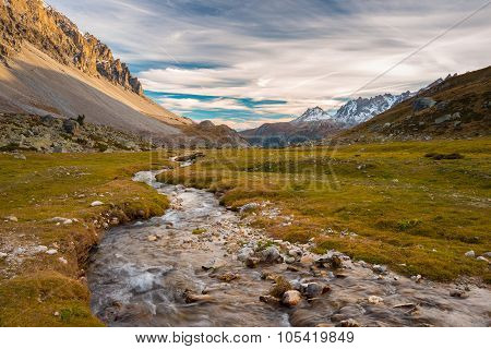 High Altitude Alpine Stream In Autumn Season