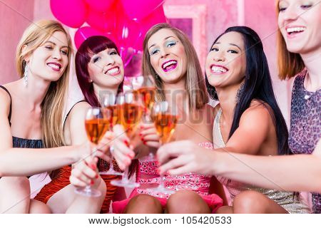 Women partying with champagne in night club