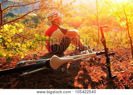 Scene of mountine bike cyclist resting in the forest