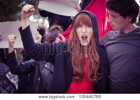 Female Protester With Raised Fist