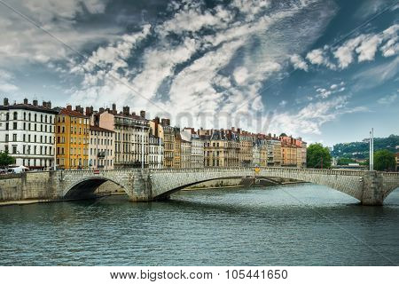 view from river Sona to the Bonaparte bridge and Lyon city against sky, France