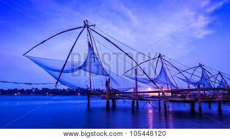 Panorama of Kochi tourist attraction -  chinese fishnets on sunset. Fort Kochin, Kochi, Kerala, India