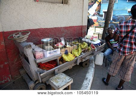 FALMOUTH, JAMAICA SEPTEMBER 27, 2015 : An unidentified man Sells Fruits and Vegetables from his push cart outside the port of Falmouth Jamaica on September 27, 2015.