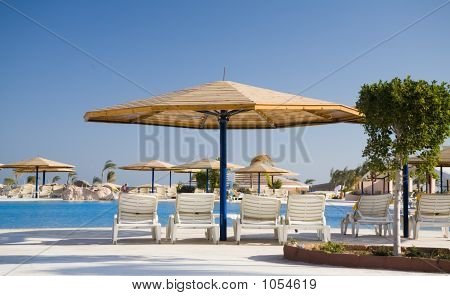 Parasol And Chaise-Longue In Hotel