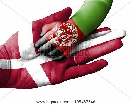 Adult Man Holding A Baby Hand With Denmark And Afghanistan Flags Overlaid. Isolated On White