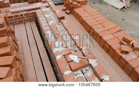 Mason bricklaying background with clay brick blocks poster