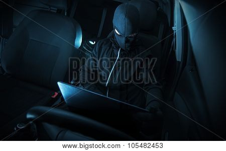 Hacking Car Systems. Hacker with His Computer at Work. poster