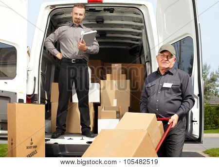 Group of delivery men with parcels near shipping truck. Parcel service.