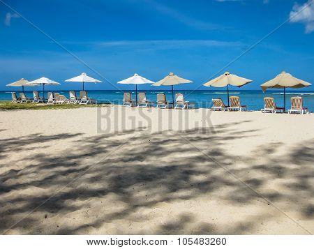 Sun umbrellas on white sand