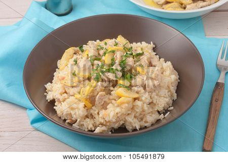 rice cooked in chicken stock and stir fried with chicken breast, zuchnini, garlic and spices garnish