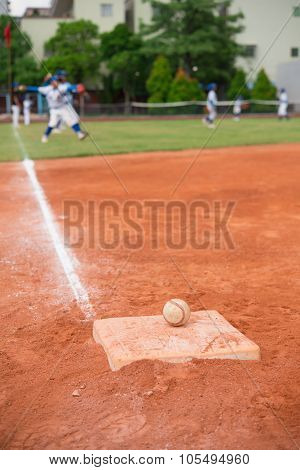 Baseball And Base On Baseball Field With Players On Background