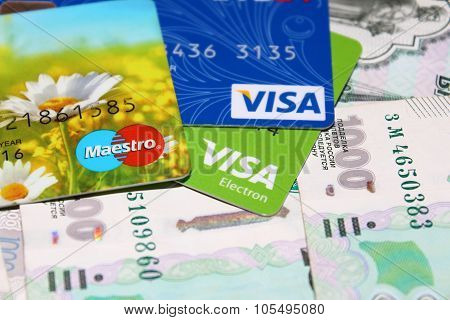 Visa cards and Maestro on a background of money
